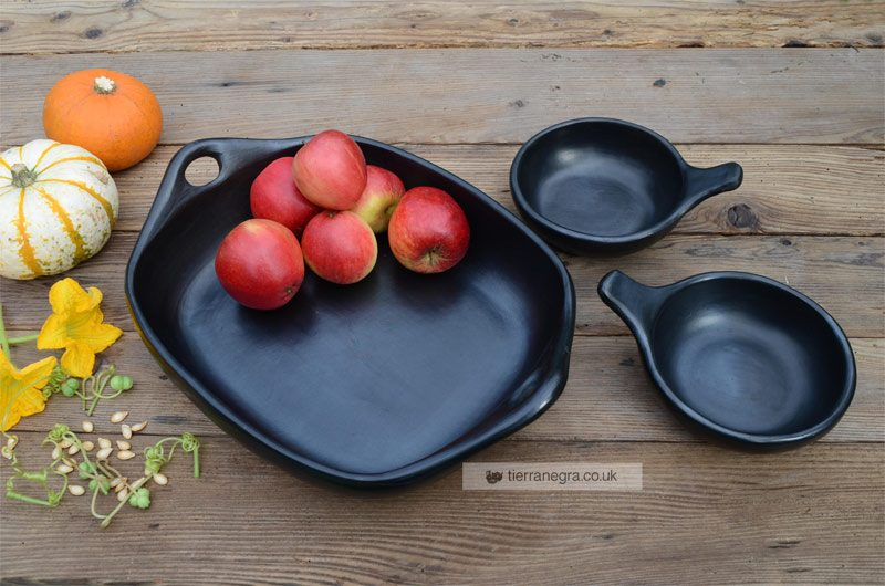 large ceramic black roaster with bowls